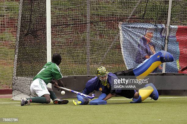 South African goal keeper Hibbert Chris blocks the ball from Nigeria's midfielder Menyei Okwudili 19 July 2007 during their African Zone Olympic men...