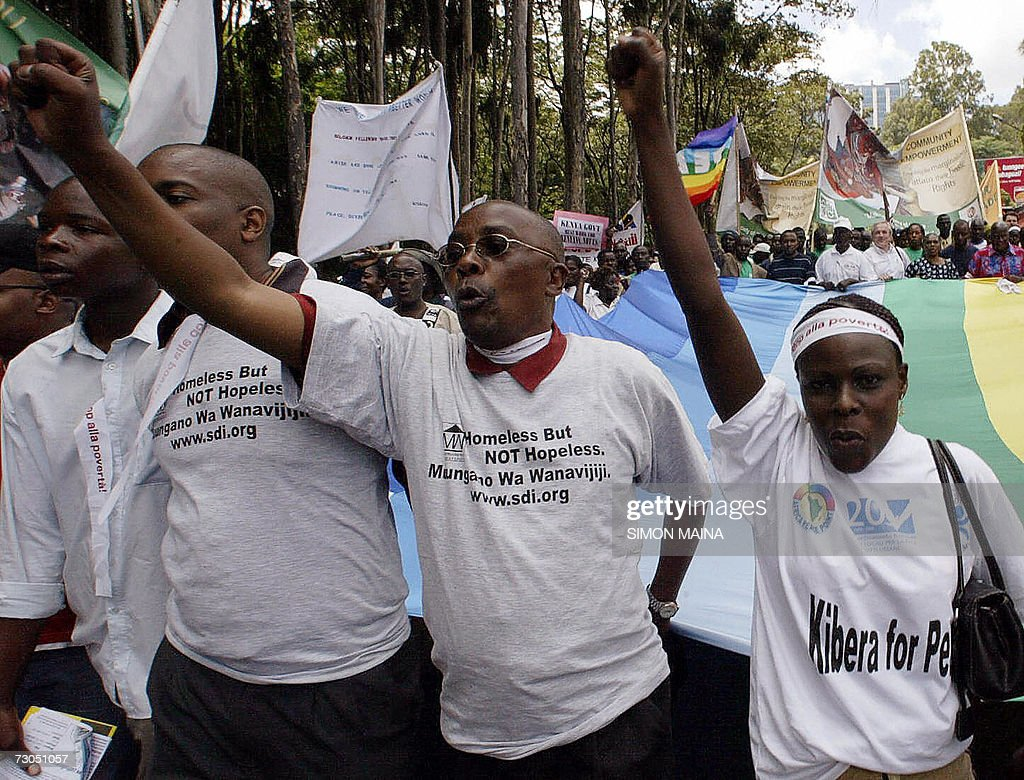 Thousands of antiglobalisation activists marching through the streets of Nairobi 20 January 2006 at the start of the World Social Forum billed as one...