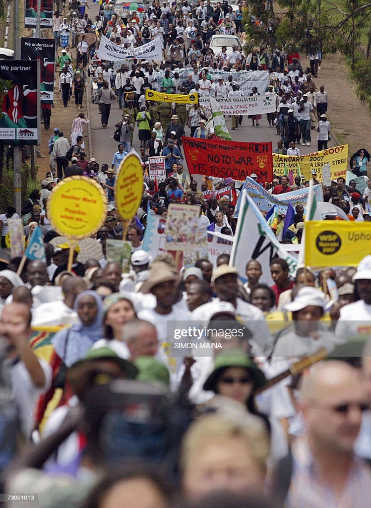 Thousands of antiglobalization activists march through the streets of Nairobi 20 January 2006 at the start of the World Social Forum billed as one of...