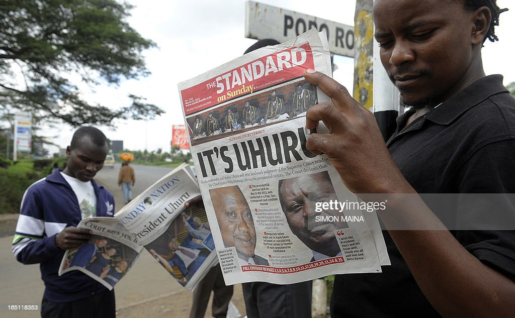 Nairobi resident read on March 31, 2013 in Nairobi the newspaper with the headline of Kenyan fourth president Uhuru Kenyatta's win, following the supreme court's decision that he was duly elected. Kenyan police beefed up security today after a court decision upholding Uhuru Kenyatta's presidential vote win drew his rival's supporters into the streets, sparking riots that left two dead. Raila Odinga had challenged the result of the March 4 poll hoping for a rerun but while he begrudgingly accepted the Supreme Court's decision on Saturday, youths in his strongholds were enraged.