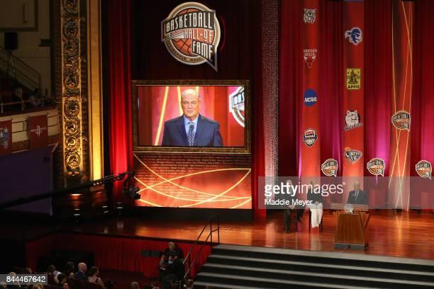 Naismith Memorial Basketball Hall of Fame Class of 2017 enshrinee Tom Jernstedt speaks as Naismith Memorial Basketball Hall of Famers Geno Auriemma...