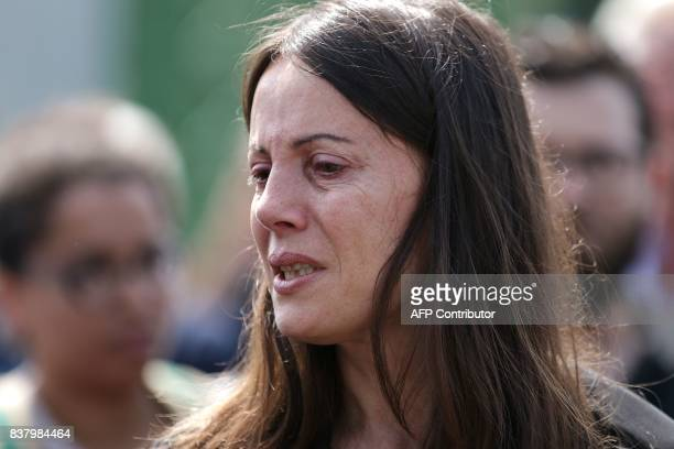 Najat sister of late Syrian actress and activist Fadwa Suleimane mourns during her funeral in Montreuil east of Paris on August 23 2017 The Syrian...