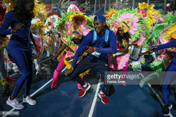 Najee Glass of Team USA celebrates with the Junkanoo dancers following the conclusion of the IAAF/BTC World Relays Bahamas 2017 at Thomas Robinson...