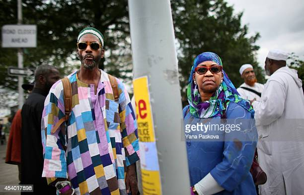 Najeeullah Najeeullah and his wife Nedra Najeeullah prepare to march in a rally against police violence on August 23 2014 in the Staten Island...
