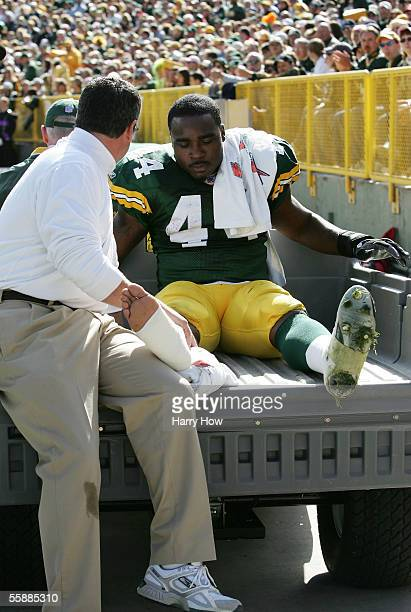 Najeh Davenport of the Green Bay Packers is carted off with an injury against the New Orleans Saints during the second quarter on October 9 2005 at...