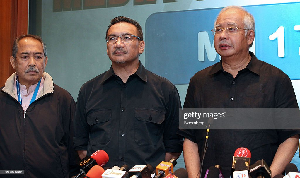 Najib Razak, Malaysia's prime minister, right, speaks, as Hishammuddin Hussein, Malaysia's defense minister, center, and Md Nor Yusof, chairman of Malaysian Airline System Bhd. (MAS), right, listen during a news conference about the crash of Malaysia Airlines Flight 17 at the Sama Sama Hotel in Sepang, Malaysia, on Friday, July 18, 2014. A Malaysia Airlines jet was shot down over eastern Ukraine, killing all 298 people on board, in an attack that the government in Kiev blamed on pro-Russian rebels. The separatists denied the accusation. Photographer: Goh Seng Chong/Bloomberg via Getty Images