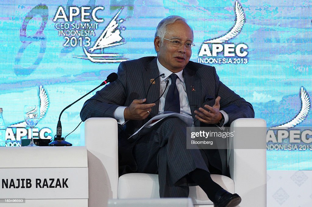 Najib Razak, Malaysia's prime minister, speaks during a panel discussion at the Asia-Pacific Economic Cooperation (APEC) CEO Summit in Nusa Dua, Bali, Indonesia, on Monday, Oct. 7, 2013. Asia-Pacific governments are calling for vigilance against protectionism as economic growth slows in parts of the region and completion of a 12-nation trade accord looks set to be delayed further. Photographer: SeongJoon Cho/Bloomberg via Getty Images