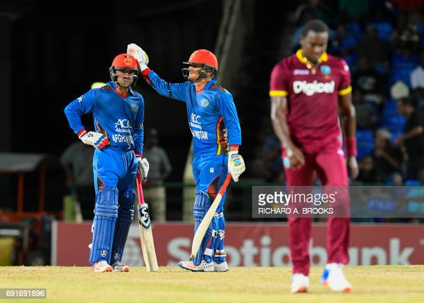 Najibullah Zadran congratulate Rashid Khan of Afghanistan for hitting 6 off Jerome Taylor of West Indies during the 1st T20i match between West...