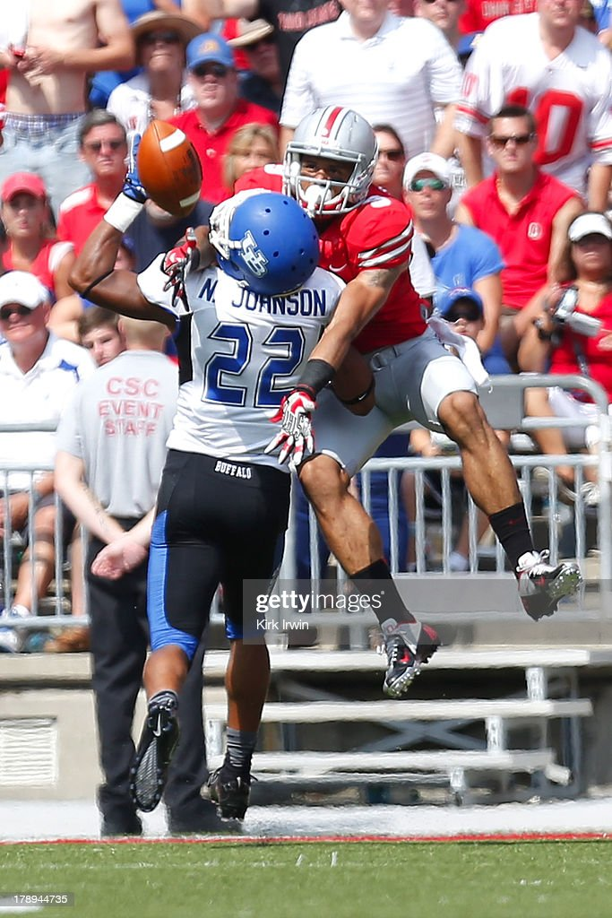 Najja Johnson #22 of the Buffalo Bulls is called for pass interference while attempting to break up a pass intended for Devin Smith #9 of the Ohio State Buckeyes during the fourth quarter on August 31, 2013 at Ohio Stadium in Columbus, Ohio. Ohio State defeated Buffalo 40-20.