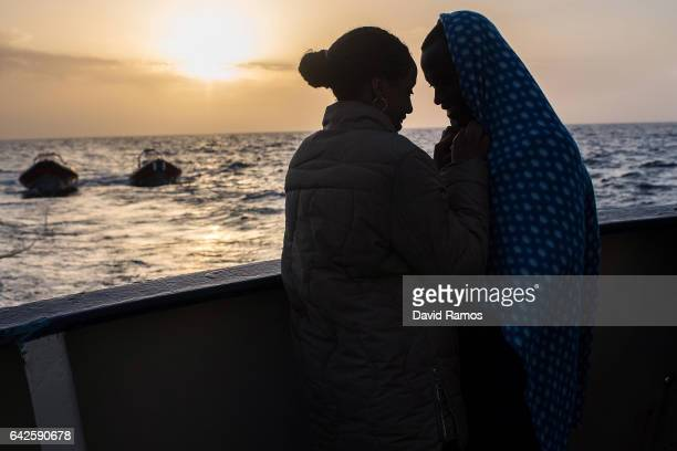 Najwa Musse and her boyfriend Suleiman Ahmed both from Libya comfort each other on the deck of the Spanish Proactiva Open Arms NGO rescue vessel...