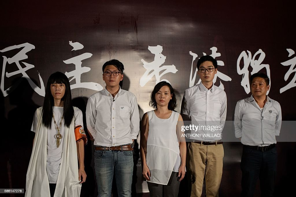 Nakade Hitsujiko Edward Leung Alice Lai Andy Chan and James Chan Kwokkeung all disqualified candidates for the upcoming elections pose for the press...