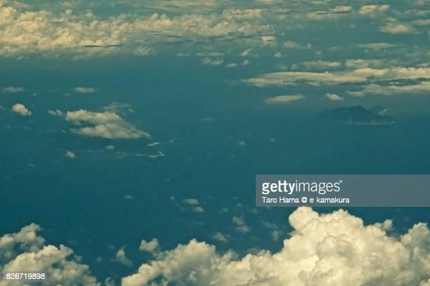 Nakanoshima and Kuchinoshima Island in Toshima village in Kagoshima prefecture day time aerial view from airplane