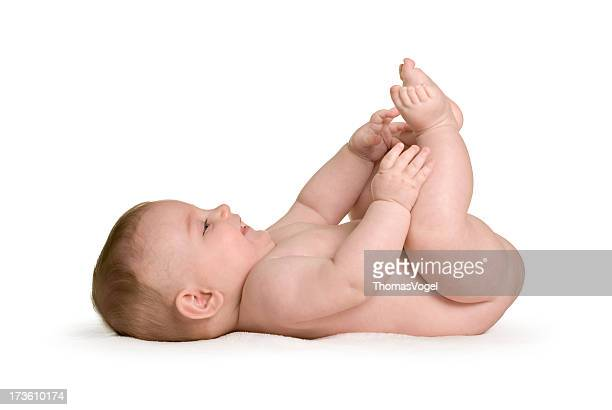 Naked baby. Isolated Lying Down Child Fun Cheerful