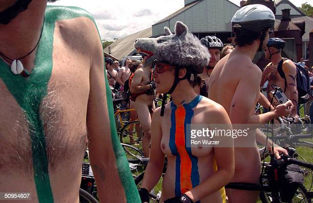 Naked bikers take part in the World Naked Bike Ride on June 12 2004 at Seattle Center in Seattle Washington Naked rides were staged 22 cities around...