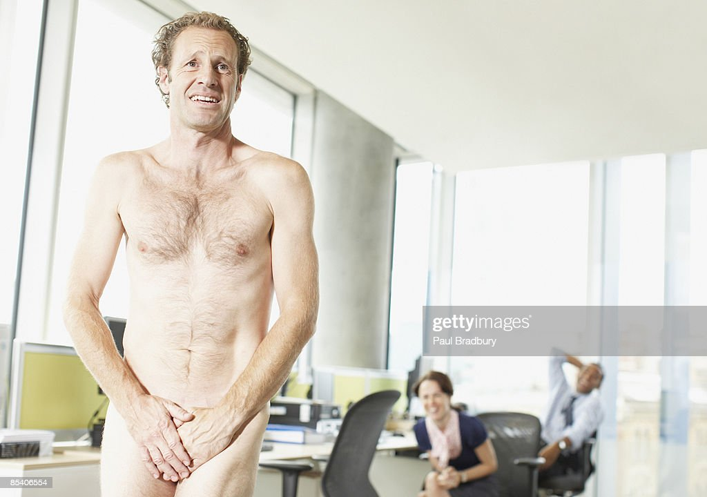 Naked businessman in office : Stock Photo