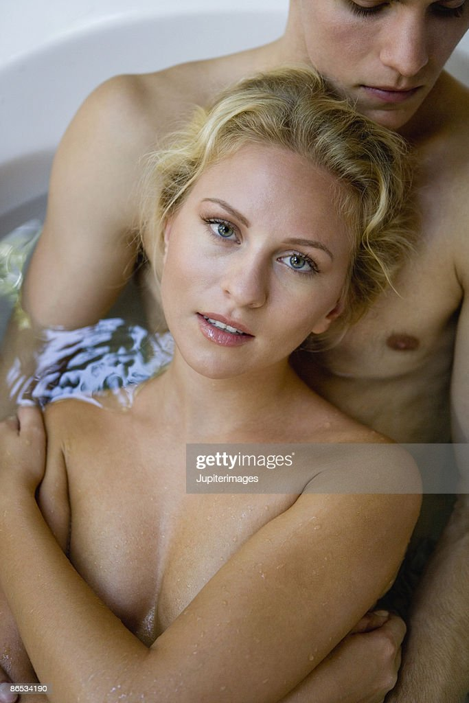 couple naked in bathtub