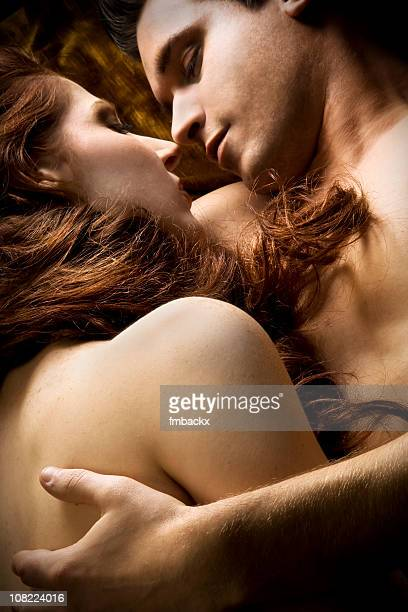 Naked Couple Lying Down and Embracing