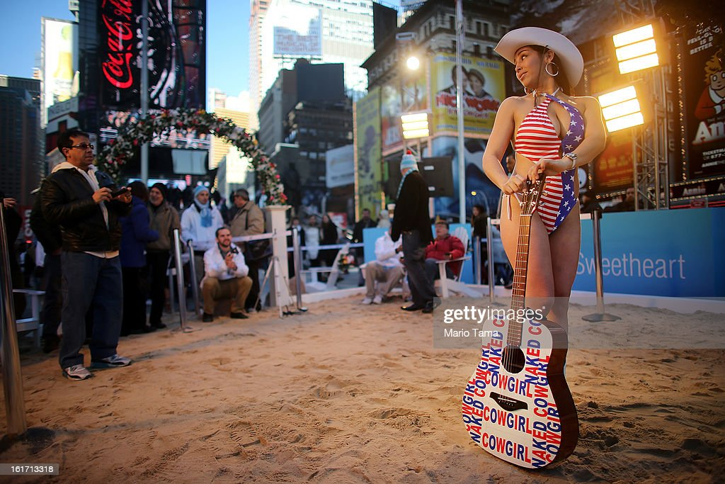'Naked Cowgirl' Alex Velandia poses on a mock heated beach in Times Square on Valentine's Day on February 14, 2013 in New York City. The mock heated beach was set up by the Aruba Tourism Authority to promote vacations to the Caribbean island during Valentine's Day celebrations in Times Square.