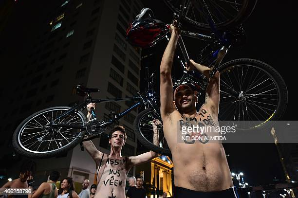 Naked cyclists ride their bikes along the Paulista Avenue to demand better conditions on roads in the city and to draw attention from car drivers as...