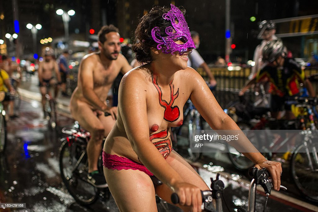 Naked cyclists take part in the 6th 'Naked Pedalling', an annual cycling event, at Paulista Avenue in Sao Paulo, Brazil, on March 9, 2013. The event welcomes naked cyclists to celebrate cycling and the human body and protest against cars, gas emission and agressive drivers. AFP PHOTO/Yasuyoshi CHIBA
