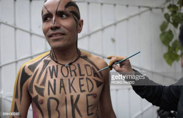 Naked cyclists take part in the World Naked Bike Ride to protest against gas emissions from cars and aggressive drivers in Mexico City on June 11...
