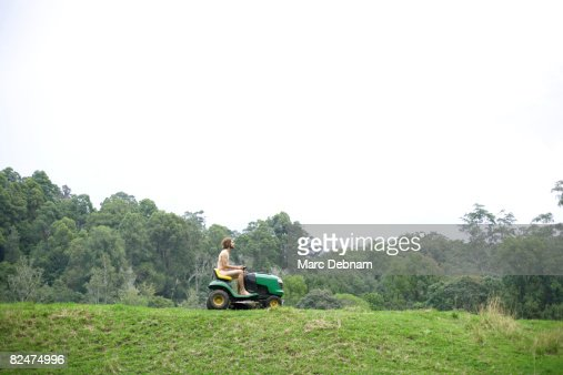 naked woman on riding lawnmower