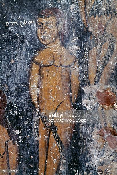 Naked man with snake fresco in the Byzantine church of Agios Ioannis Deliana Crete Greece