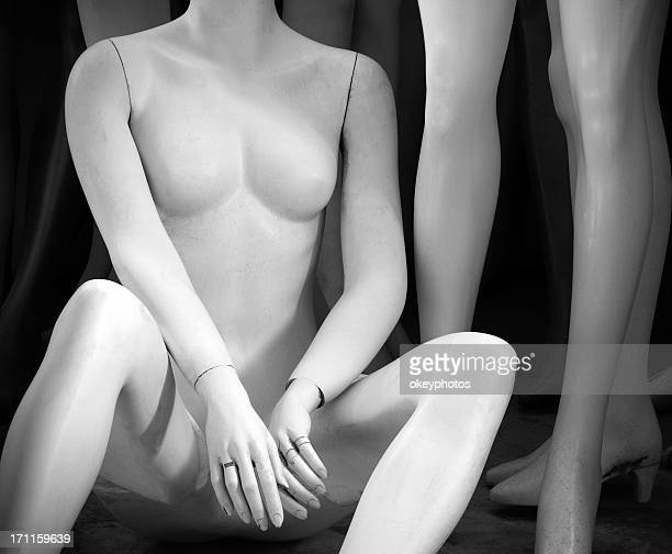 Naked mannequin sitting.