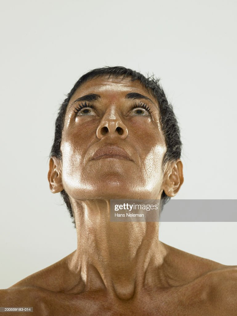 Naked Mature woman looking up, close-up : Stock Photo