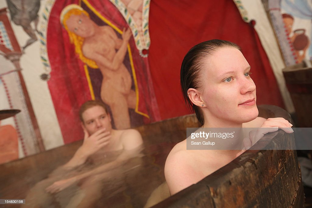 Naked participants of a Middle Ages reeneactment club mellow in the hot water of a wooden tub meant to illustrate the use of baths in the Middle Ages during celebrations marking the 775th anniversary of the city of Berlin on October 27, 2012 in Berlin, Germany. Celebrations are continuing over the weekend and will culminate in a fire presentation by the French fire performers Carabosse on Sunday. The settlement of Coelln, which stood opposite Berlin on the Spree river, is first referred to in a document from 1237, and by the beginning of the 14th century Coelln and Berlin joined together to become the region's most important trading center.