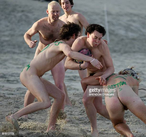Naked players participate in the traditional game of 'naked Rugby at St Kilda beach in Dunedin on July 12 2008 prior to the New ZealandSouth Africa...