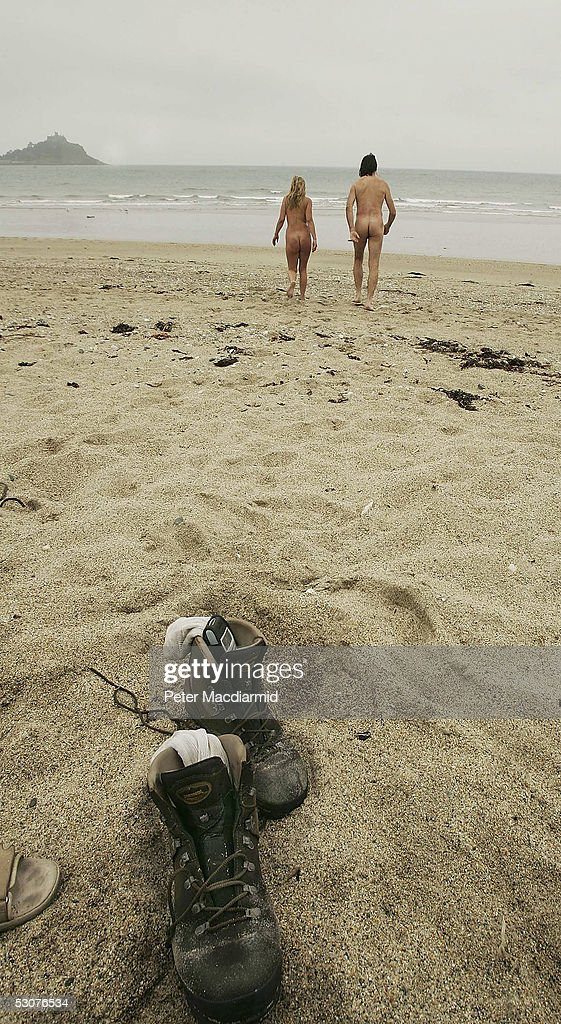 Naked ramblers Stephen Gough (R) and Melanie Roberts are seen on the beach at the end of their first days walk to John O'Groats on June 16, 2005 at Penzance, England. Gough took the same challenge two years ago and was arrested 14 times.
