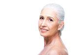 beautiful smiling naked senior woman, isolated on white