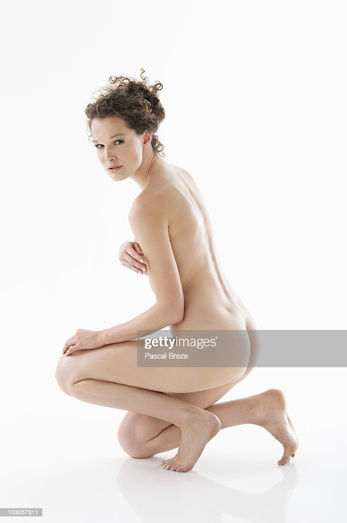 Naked girl covering boobs
