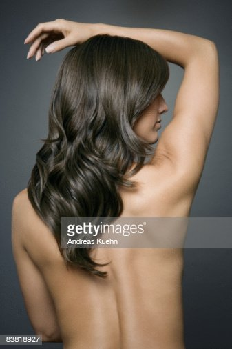 detail photo naked woman with long shiny black hair back high res stock photography