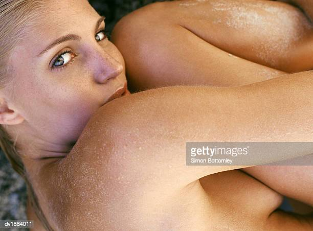 Naked Woman Lying Naked in the Fetal Position