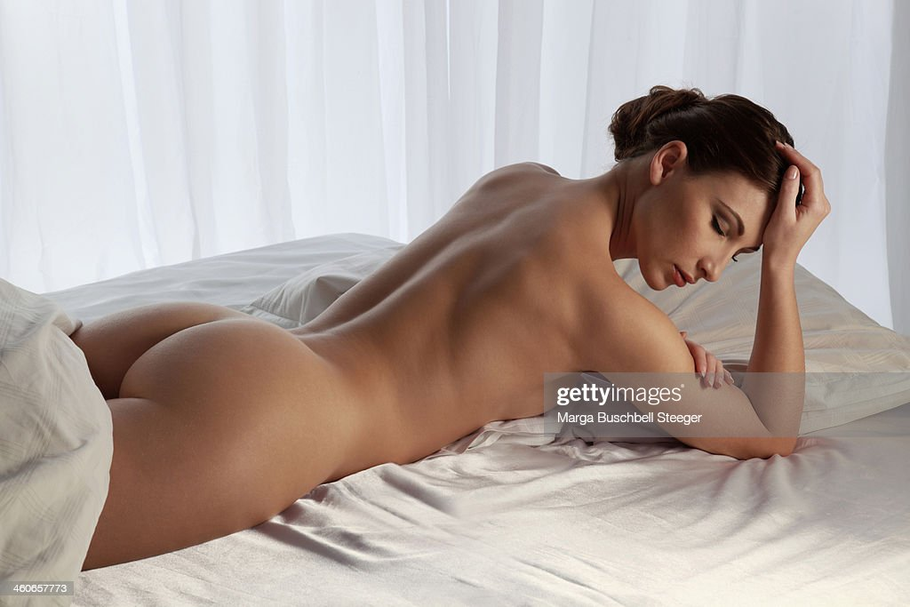 Naked woman on bed : Stock Photo