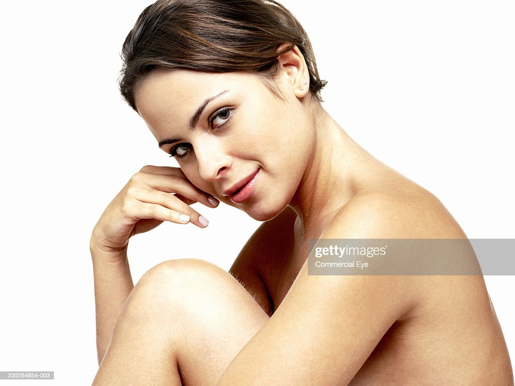 Naked woman resting head on hand, portrait : Stock Photo