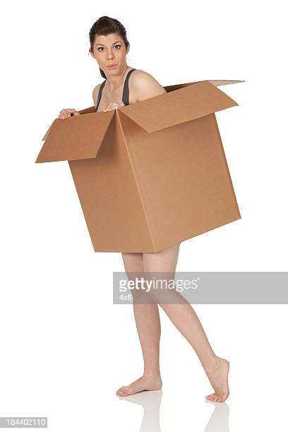 Naked woman under a cardboard box