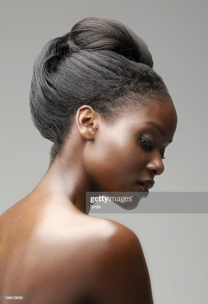 Naked woman with hair tied up : Stock Photo