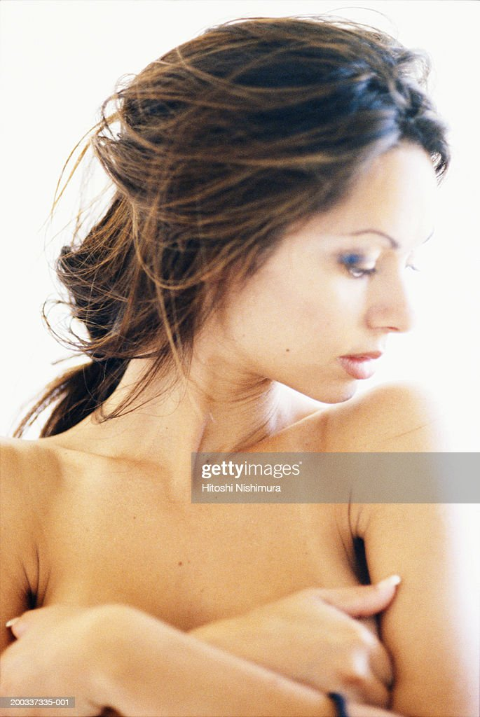 Naked woman with hands covering breast : Stock Photo
