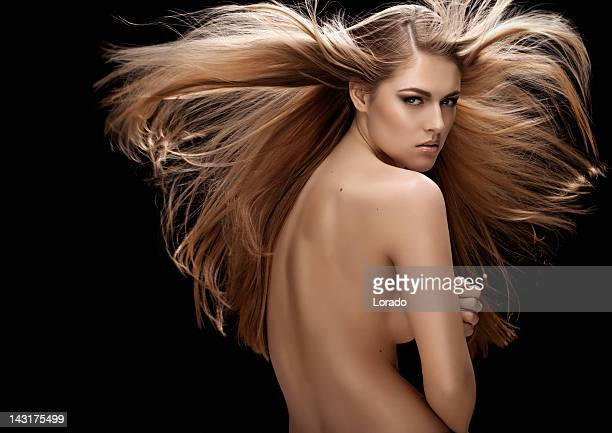 naked woman with long blond hair flying