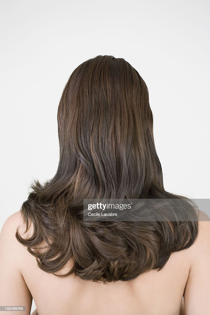 Naked woman with long brown hair, rear view : Stock Photo