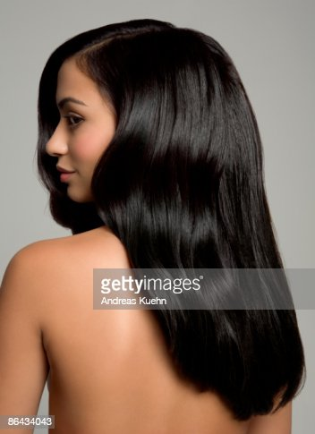 Naked woman with long shiny black hair, back view. : Stock Photo