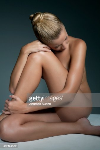 Naked woman with shiny hair do sitting, side view. : Stock Photo