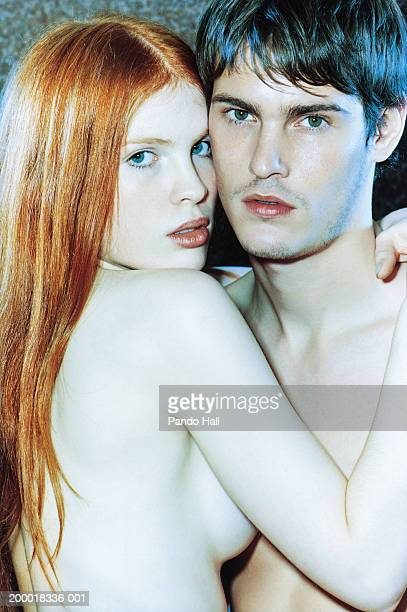Naked young couple embracing, portrait