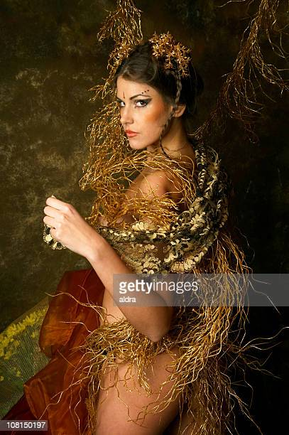 Naked Young Fairy Woman Posing with Gold Twigs