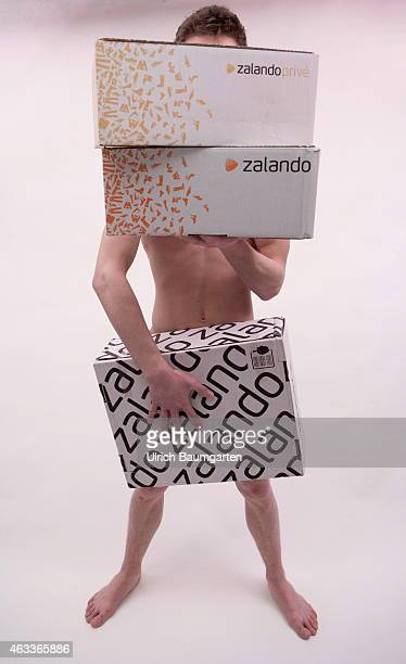 Naked young man with Zalando packages Symbol photo on the topics shopping returning business model etc on Fruary 13 2015 in Bonn Germany