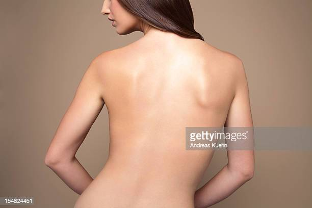 Naked young woman back view.