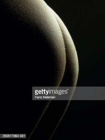 Naked young woman, close-up of buttocks, mid-section, side view : Stock Photo